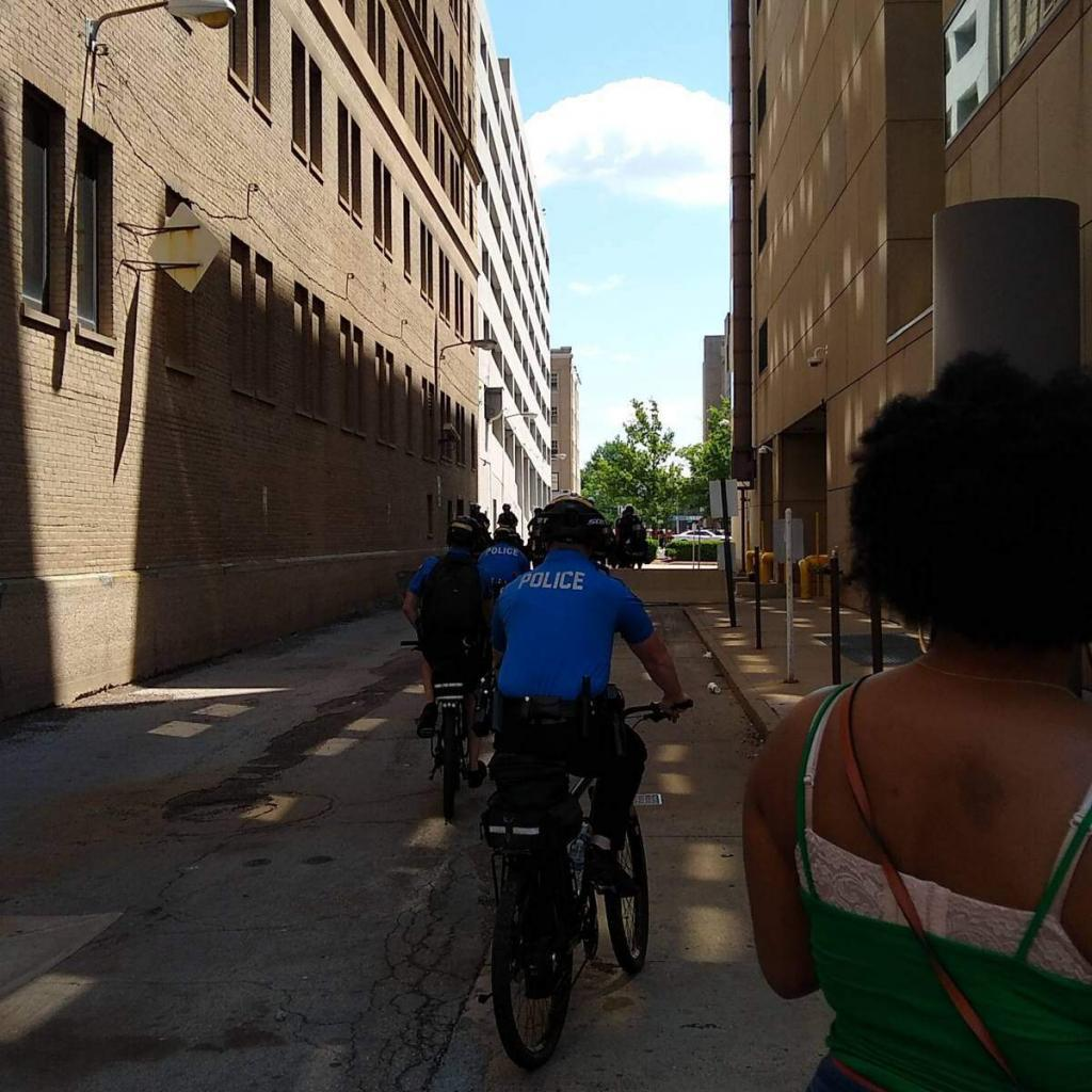 Mounted police and bicycle police blocking an alley leading away from Courthouse Square.